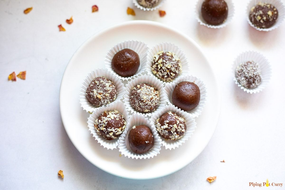 These Chocolate Ladoos Made With Almond Flour Condensed Milk And Cocoa Are Sure To Satisfy Your Cravings In 2020 Easy Chocolate Chocolate Almonds Coconut Ladoo Recipe