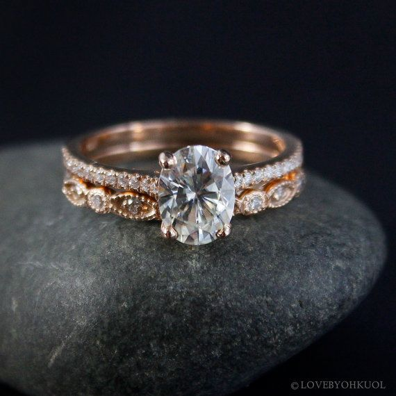 Our intricate and unique wedding band paired with an oval solitaire ...