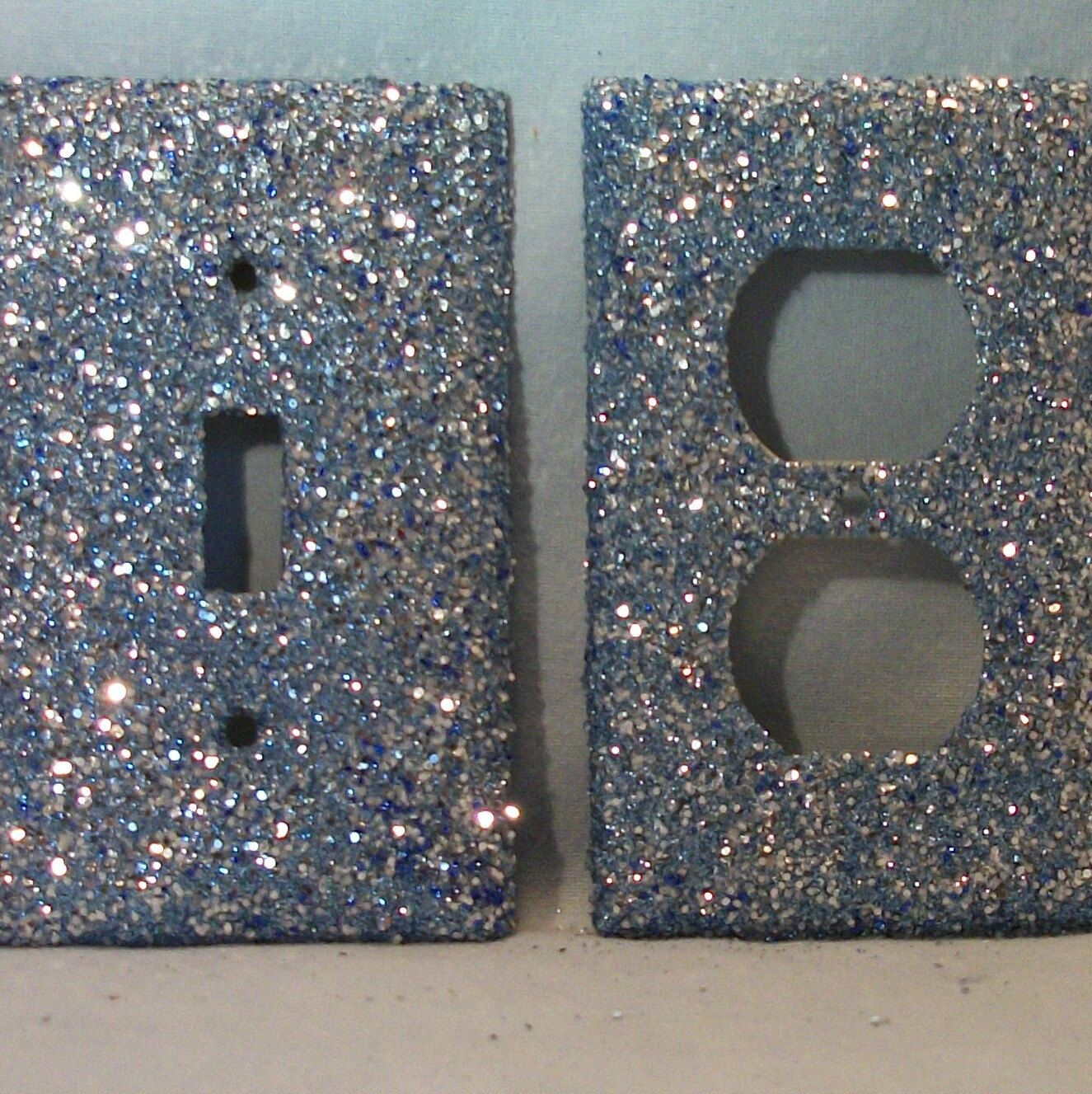glitter light switch plate! Did this with modge podge and craft glitter 4 months ago on all Kyleigh's switch plates and so far it holds GREAT!  I was worried, it takes 2-3 coats though and make sure to modge podge over the top really well.