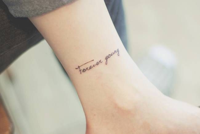"Ankle tattoo saying ""Forever young"" by Seoeon."