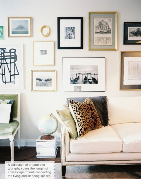 awesome gallery wall - leopard pillow - via Lonny Mag
