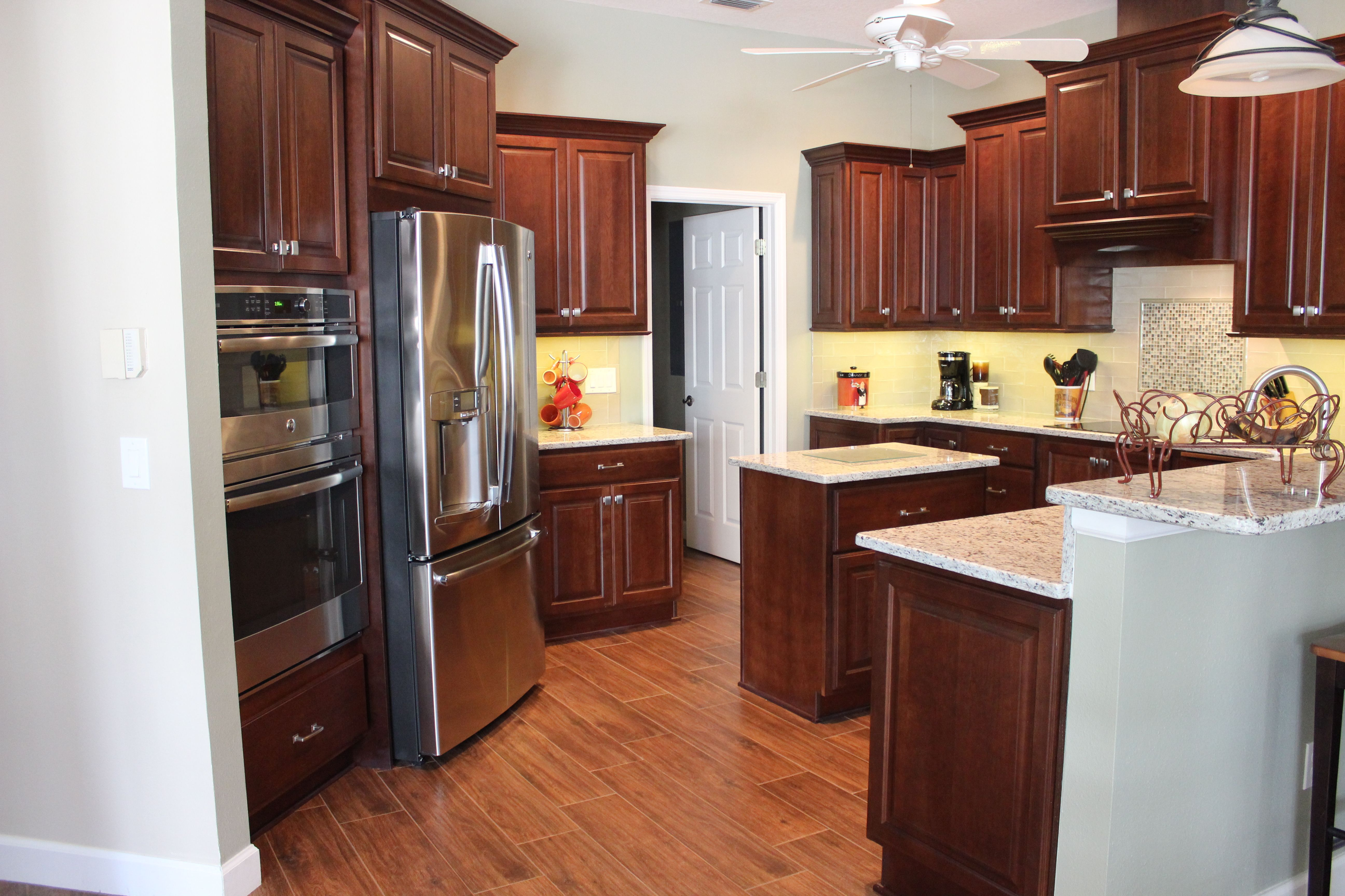 These Dark Wood Cabinets By Showplacecab Lend Such A Rich Look To This Kitchen With Granite Countertops S Wall Oven Kitchen Kitchen Kitchen Bathroom Remodel