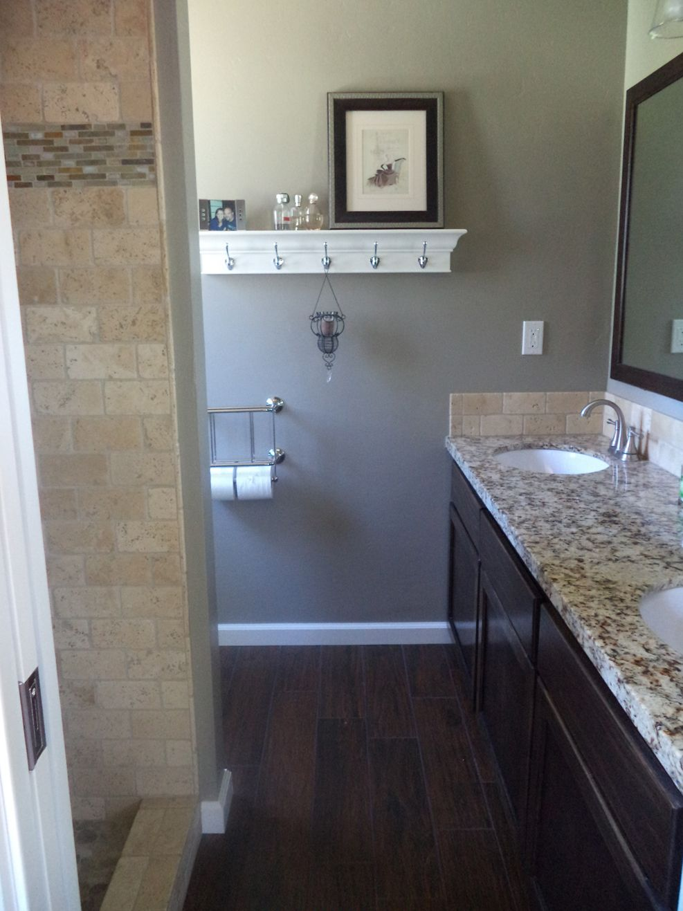 the new small master bathroom dark tile floors that look