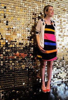 A wall of gold metallic awesomeness! Accomplished with a gold wall, pins, some small beads to create space between the pailettes and the wall, and a few thousand of these: http://www.mjtrim.com/catalog/product/1050765/26716/26716.aspx