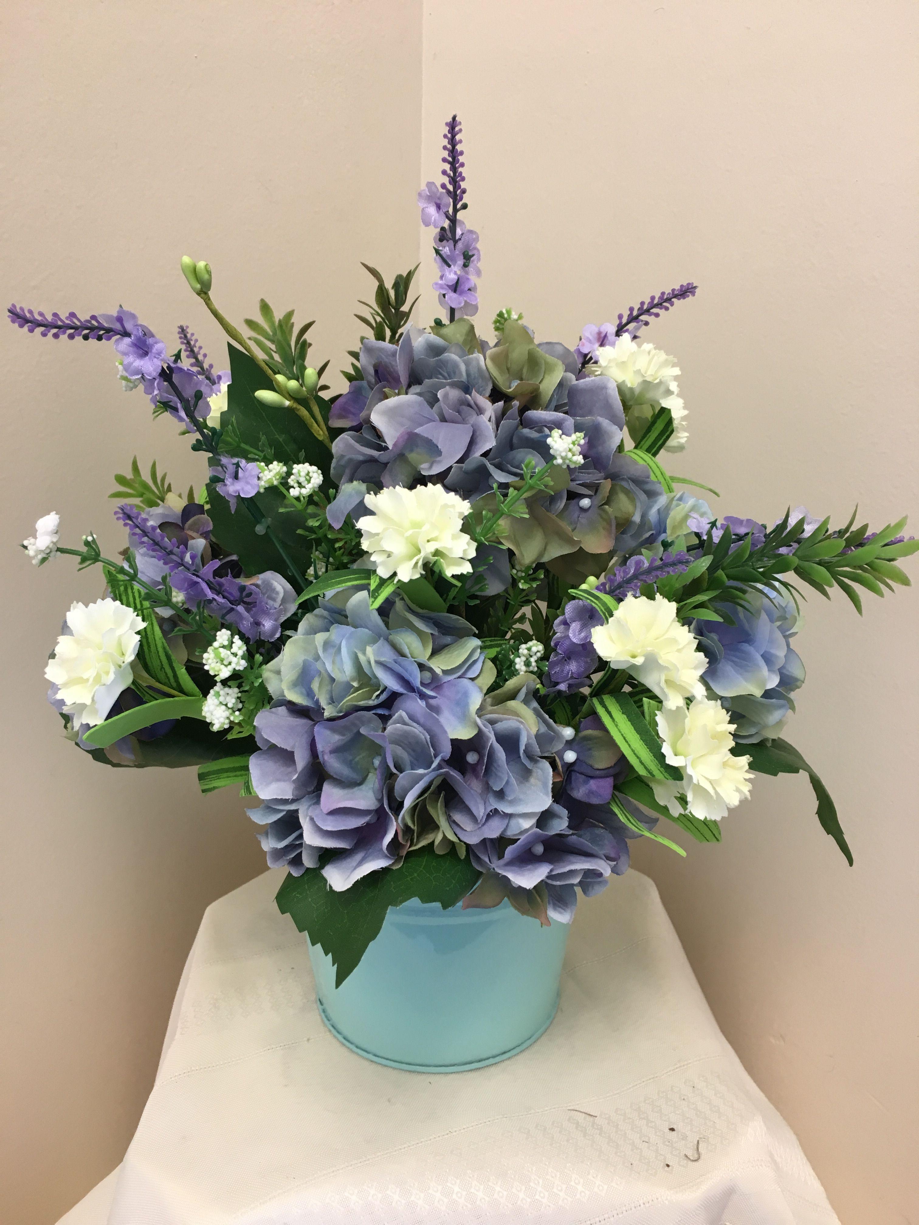 All Around Artificial Flower Arrangement In Aqua Tin With Blue Lavender Hydrangea And Cream Filler