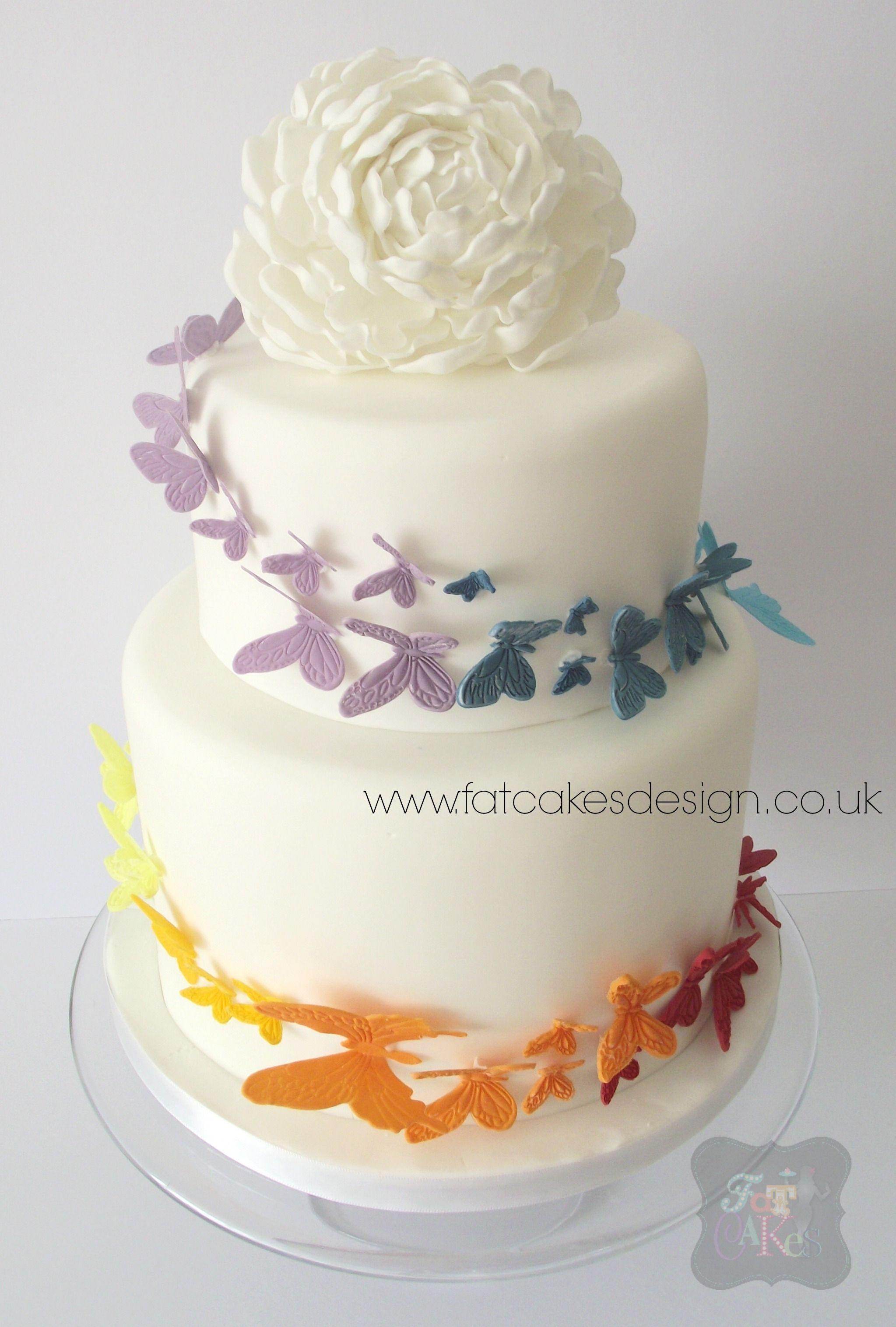 Spiralling rainbow of butterflies two tier wedding cake