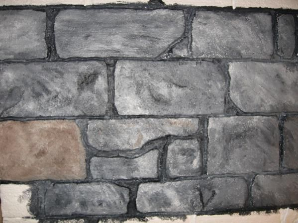 faux stone wall from foam sheet painted after using heat gun to make brick outlines. Black Bedroom Furniture Sets. Home Design Ideas