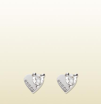 fb16faad217 earrings with Gucci logo engraved heart motif.