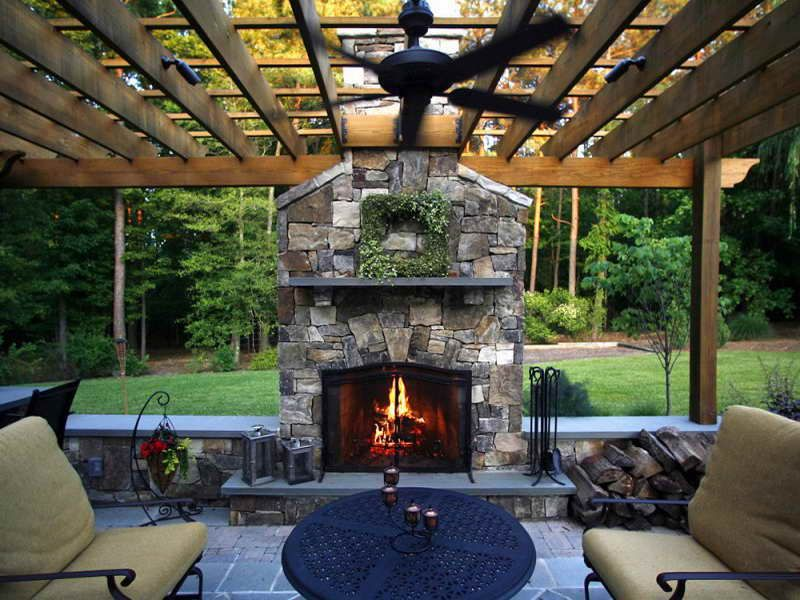 classic stone fireplace in outdoor living spaces with metal