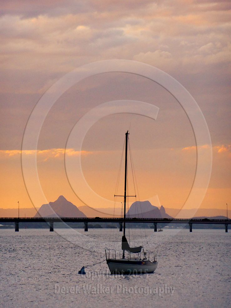 A yacht anchored in the Pumicestone Passage at sunset, with the Glasshouse Mountains in the distance. Bribie Island, Queensland, Australia.  For image licensing enquiries, please feel welcome to contact me at derekwalker73@bigpond.com  Cheers :)
