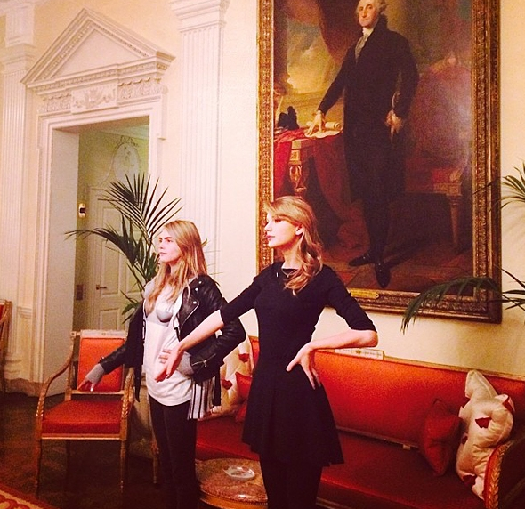 February 6: Taylor Swift and Cara Delevingne do their best George Washington pose.