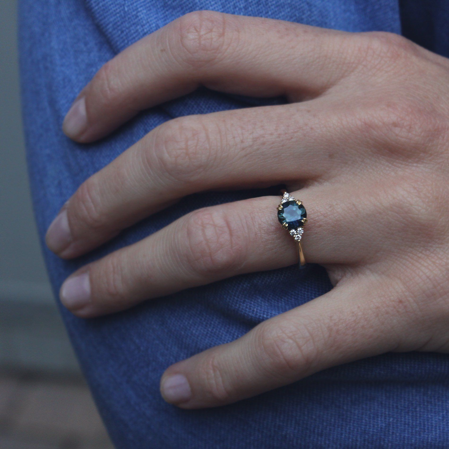 Teal Sapphire Engagement Ring with Diamond Detailing