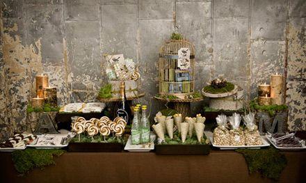 Candy table con jaulas antiguas y pajaritos.