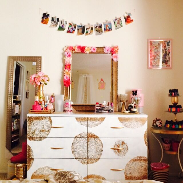 The other side has a dresser and my tall mirror. I jazzed up my plain mirror with flowers.