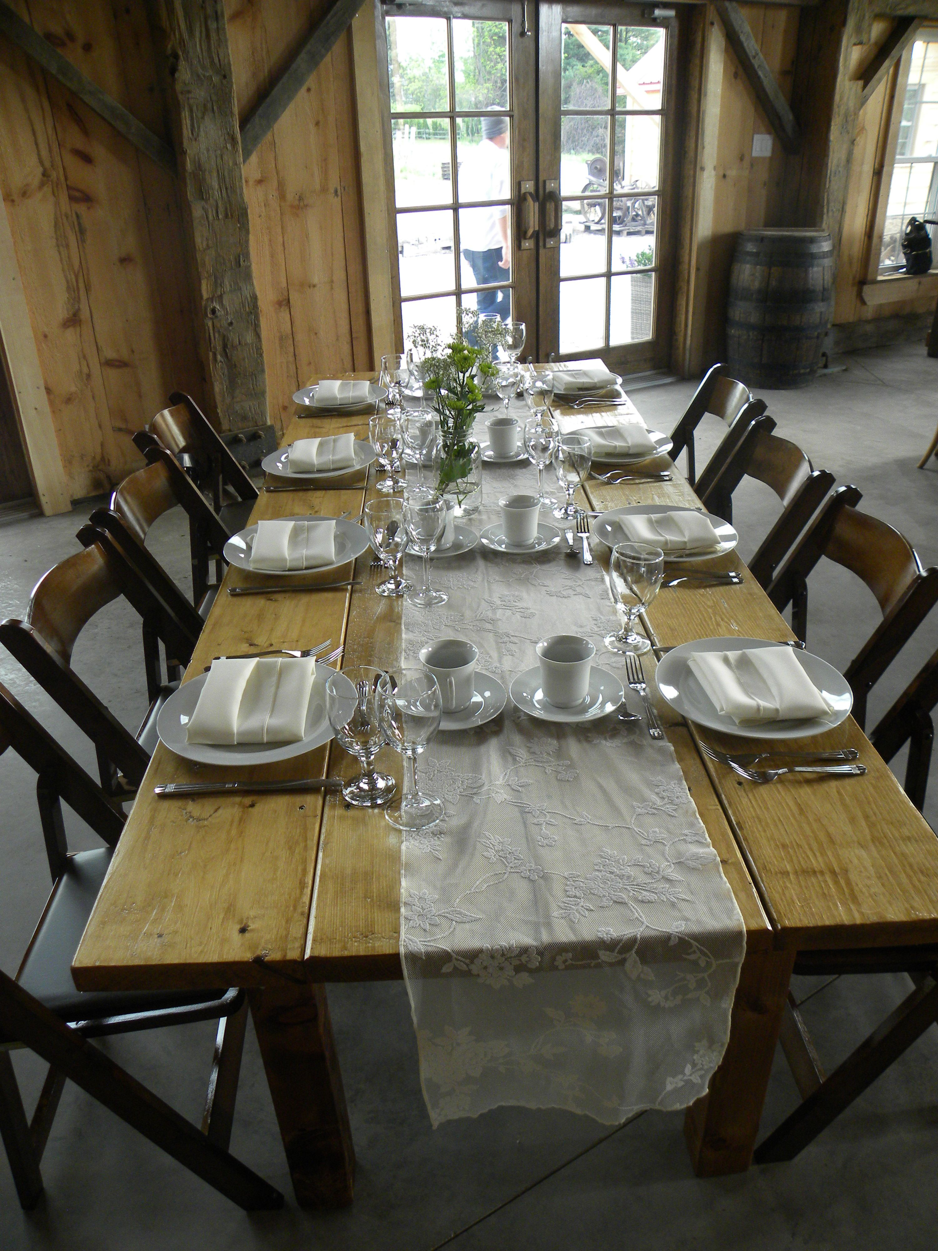 True Harvest Table With Lace Runner And Wooden Folding Chairs