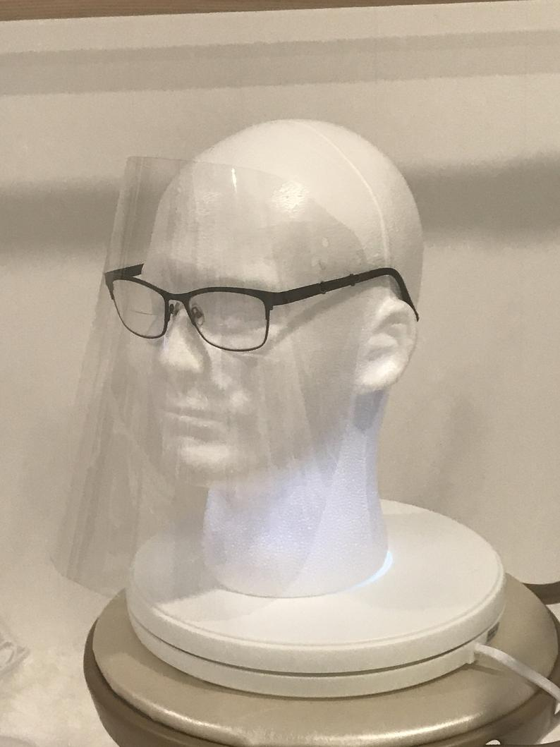 Face shield simply attaches to any glasses no ties precise