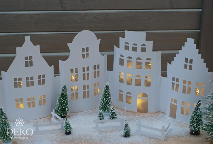 DIY: weihnachtliche Fensterdeko mit hübscher Häuserzeile aus Papier