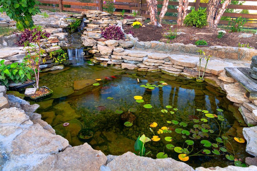 Koi pond design and construction in kansas city prestige for Outside fish pond