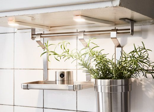 A kitchen is lit up with task lights attached to the countertop - ikea küche kosten