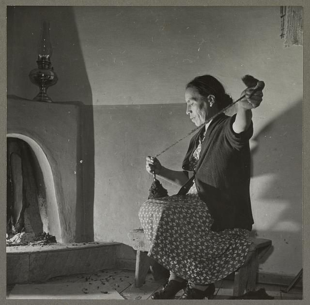 Title: Trampas, New Mexico. Maclovia Lopez, wife of the majordomo (mayor), spinning wool by the light of the fire. The family has ten sheep and they spin the wool for blankets, which are woven for them in Cordova Creator(s): Collier, John, 1913-1992, photographer Date : 1943 Jan.