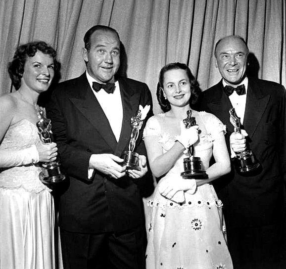 Mercedes Mccambridge (Best Supporting Actress), Broderick Crawford (Best Actor), Olivia Dehavilland (Best Actress) and Dean Jagger (Best Supporting Actor) in 1950