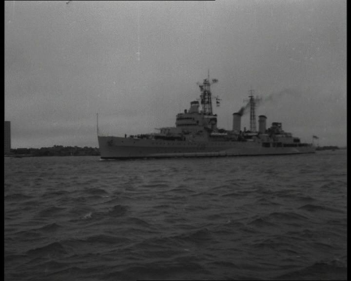 HMS Belfast sets off for Gibraltar in this 1963 film: http://www.britishpathe.com/video/cadets-try-sea-life