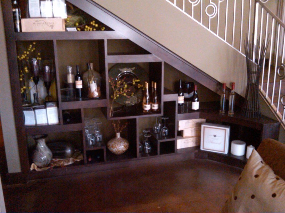 Wet bar under stairs jpg bookcase under stairs for Dining room under stairs
