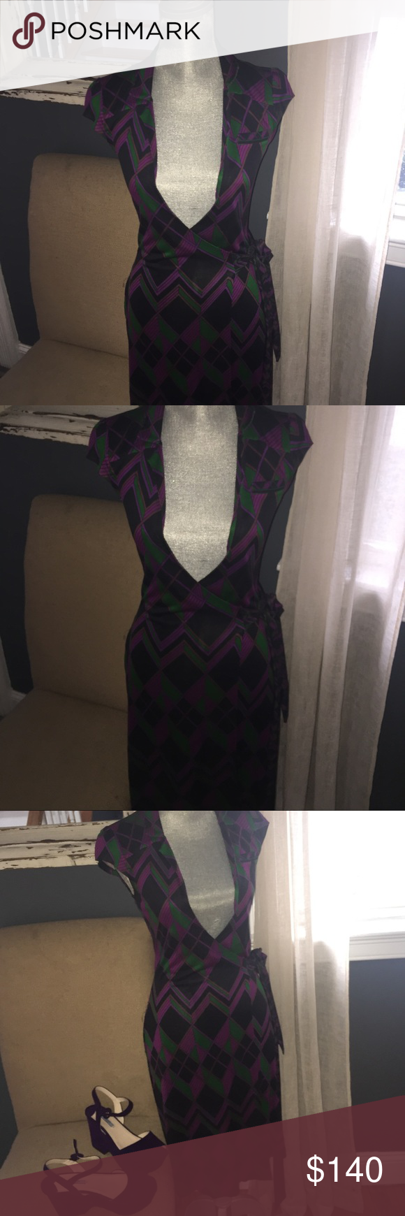DVF ICONIC WRAP DRESS Nobody does a better WRAP dress than Diane Von Furstenberg!! Gorgeous jewel tone colors of purple , black and green with cutesy cap sleeves,looks amazing with my  purple suede Prada platforms ! Only worn 1 time ! Will give u a killer bundle deal if u purchase both (see Prada shoes in separate listing ) Diane von Furstenberg Dresses Midi