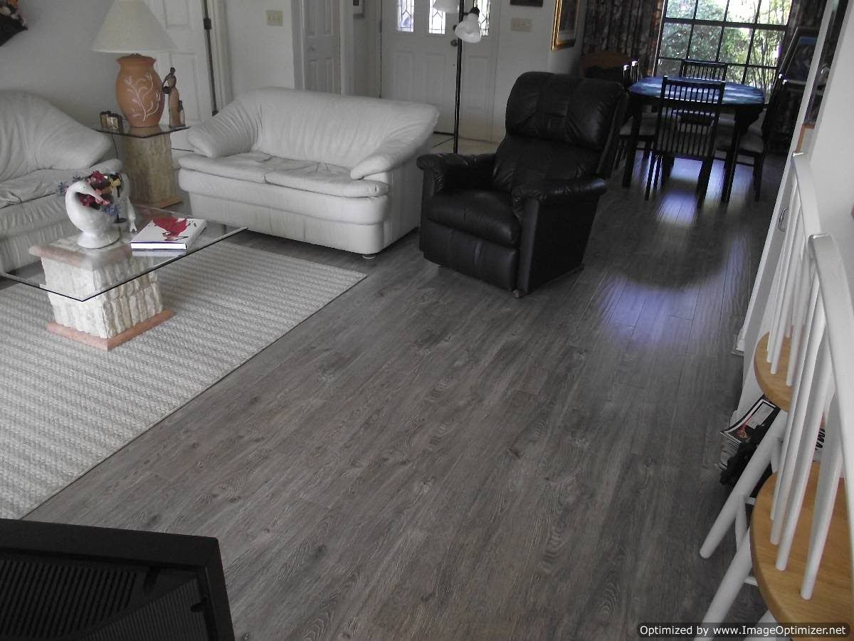 Floor glossy grey laminate flooring below white and black leather floor glossy grey laminate flooring below white and black leather sofa and chairs also glass dailygadgetfo Gallery