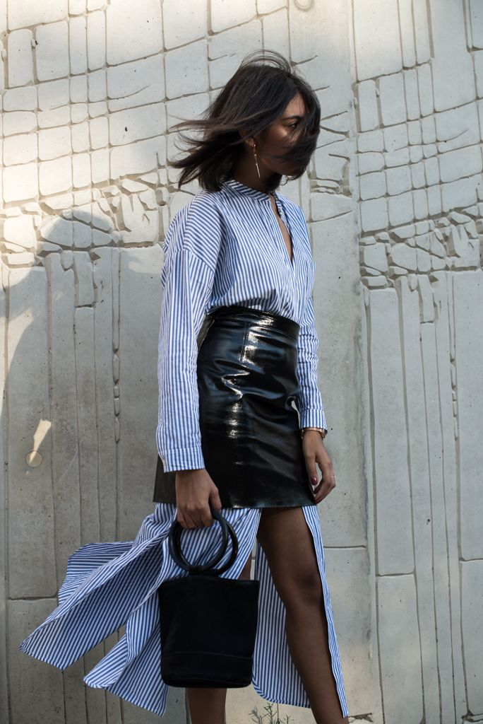storm wears leather patent skirt from &other stories with simon miller black bag and madeline issing earrings