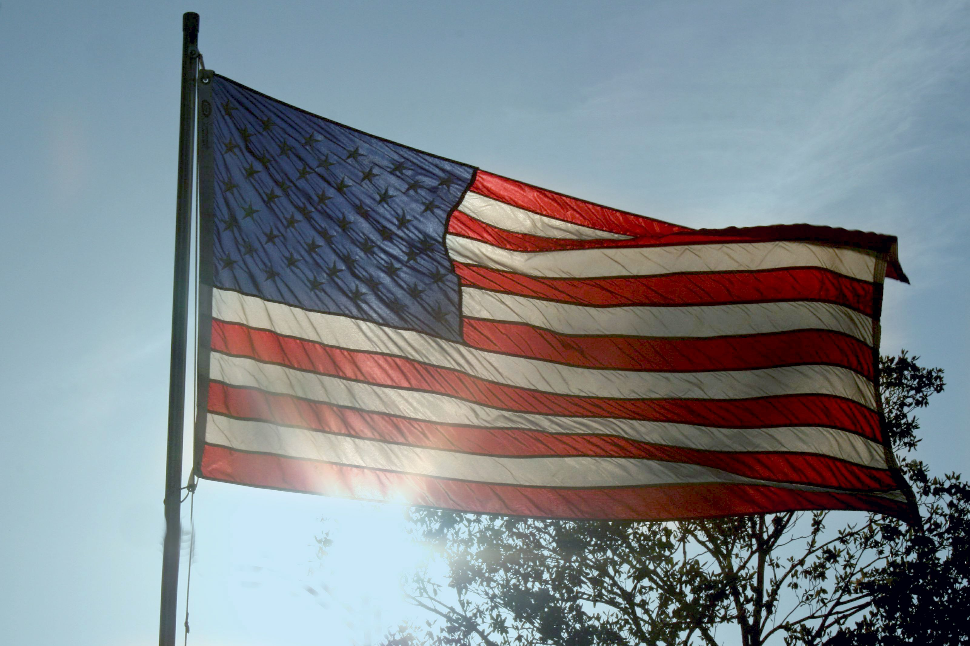 red white and blue flag with one star