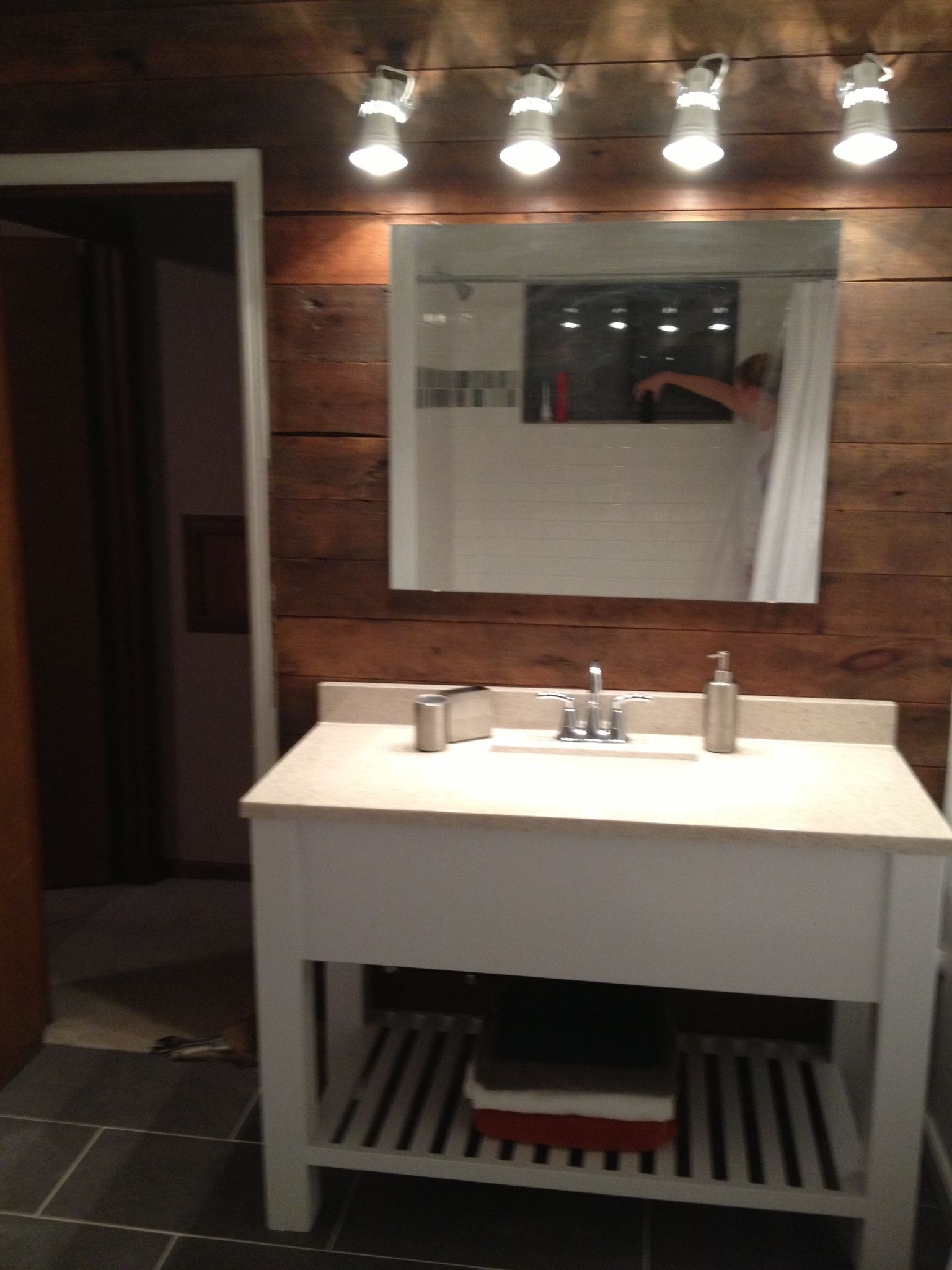Bath vanity. Barn wood wall. Ikea lights. White modern rustic. Grey tile. Open shelf vanity ...