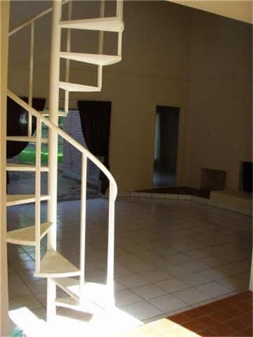 Great spiral staircase leading to loft area