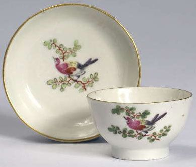 A rare Worcester porcelain ornithological miniature tea bowl and saucer, circa 1772 to 1775, painted with a bird