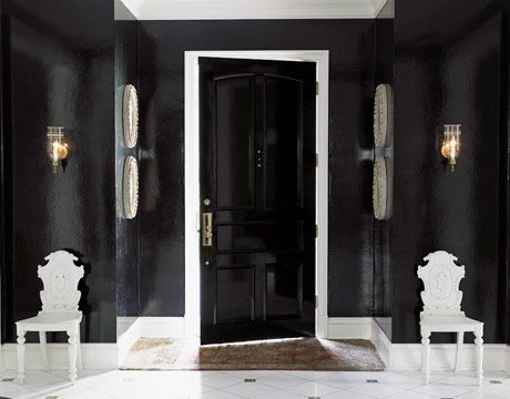 I never think of black as the color to paint the walls - but a room like this is so elegant and sexy! What a sophisticated way to greet your guests!