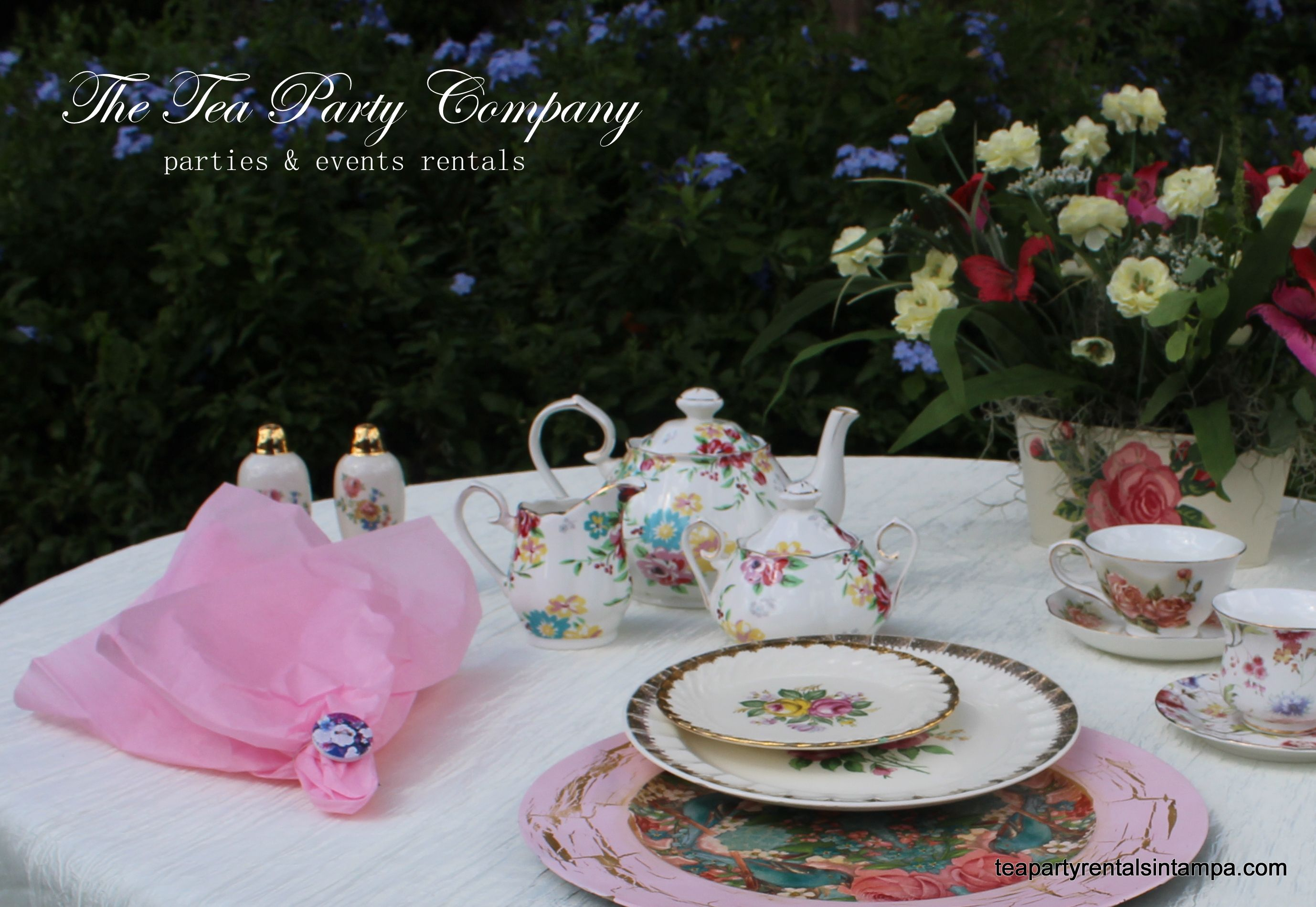 very pink tea party! Vintage salad plates, Decoupaged Chargers Matching Teapots Sets Flower Centerpiueces. All for rent @ The Tea Party Company