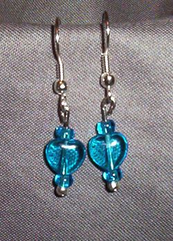 Aqua Blue Heart - see through aqua blue heart with aqua blue beads surrounding both sides.