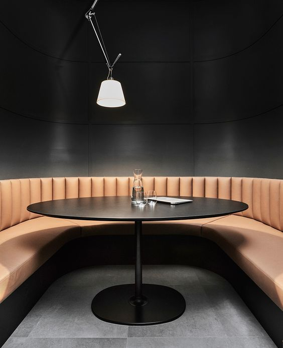 Cognac Coloured Tan Bench Seating Against Dark Walls