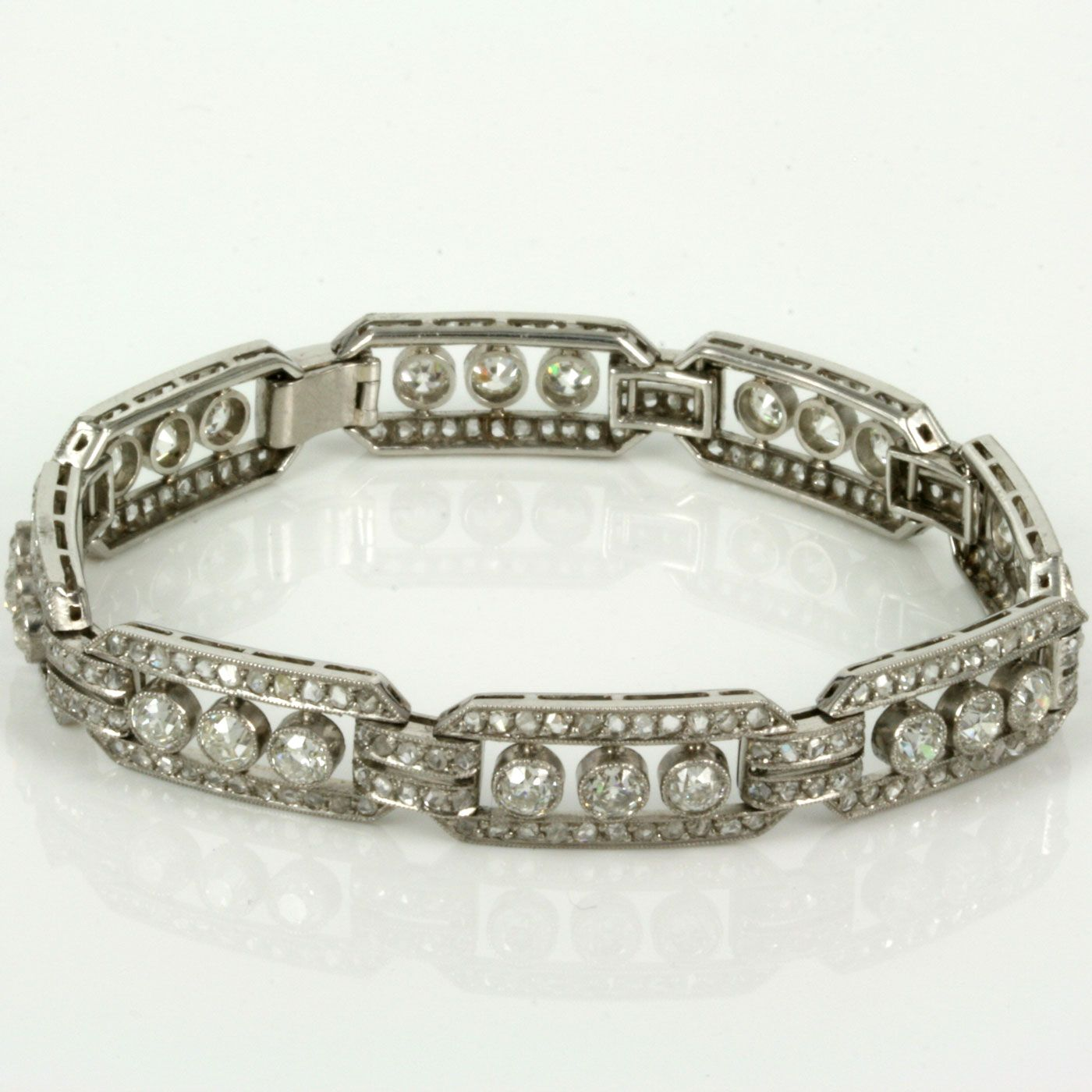 Here is a truly magnificent diamond bracelet made in the Art Deco period of the 1920's that has been all hand made in platinum and set with an incredible 104 diamonds in the most elegant and sophisticated design. Jewellers of the 1920's really knew how to created masterpieces and this is one of those pieces. Measuring 17.4cm in length and 9.4mm wide, this Art Deco diamond bracelet sits so well on the wrist and thanks to all of those diamonds sparkles so brilliantly. There are a total ...