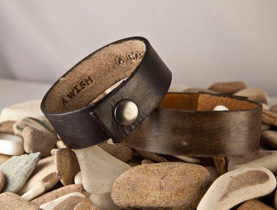 Men's bracelet with a secret message inside.  I'd get the black one.