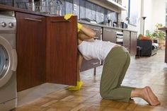 How To Get Rid Of An Old Musty Smell In Kitchen Cabinets Clean Kitchen Cabinets Laminate Furniture Laminate Kitchen Cabinets