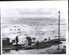 1956 Press Photo Revere, MA Residents View Coast Wall High Water Wave Damage