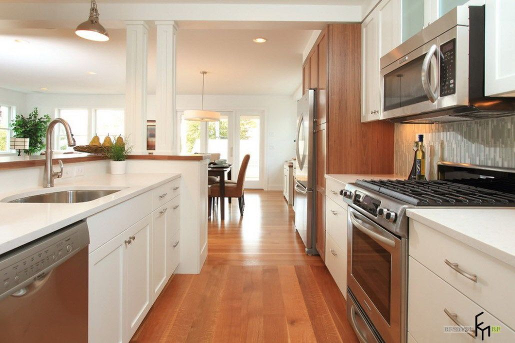 White Galley Kitchen With Island a luxurious kitchen hallway with laminate flooring and marvellous