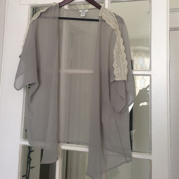 Flirty gray lace shrug Drapes over body, never worn, beautiful lace embroidery on both sleeves, which are about 3/4 length. Bar III Sweaters Shrugs & Ponchos