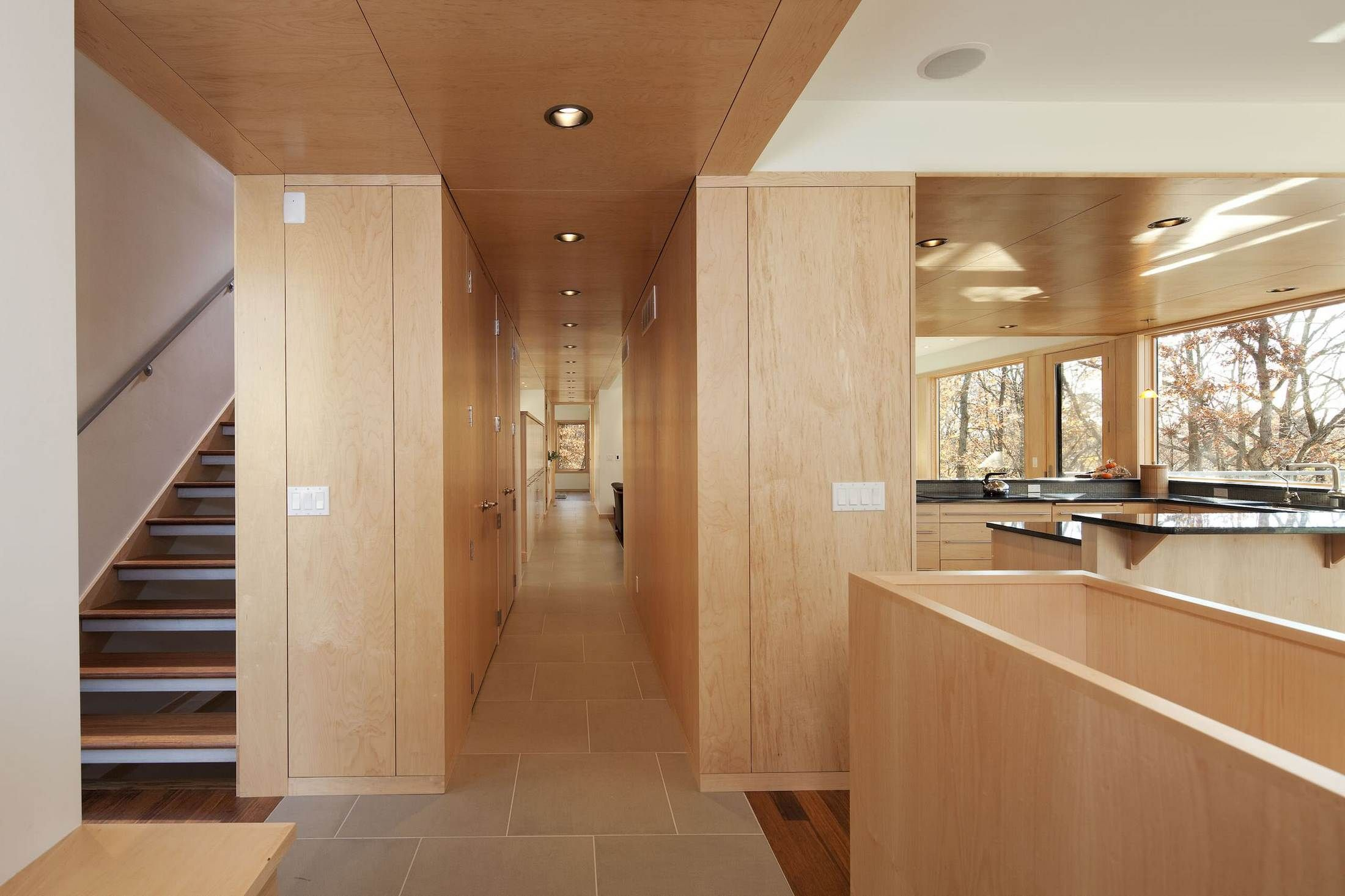 Long hallway with plywood ceilings   | Usual House