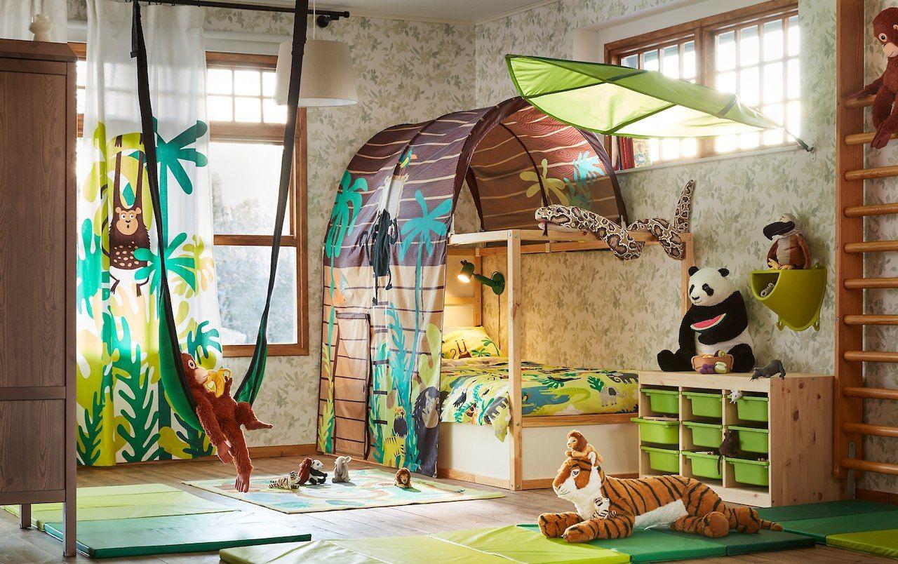 A brown and green jungle safari theme childrenus bedroom with KURA