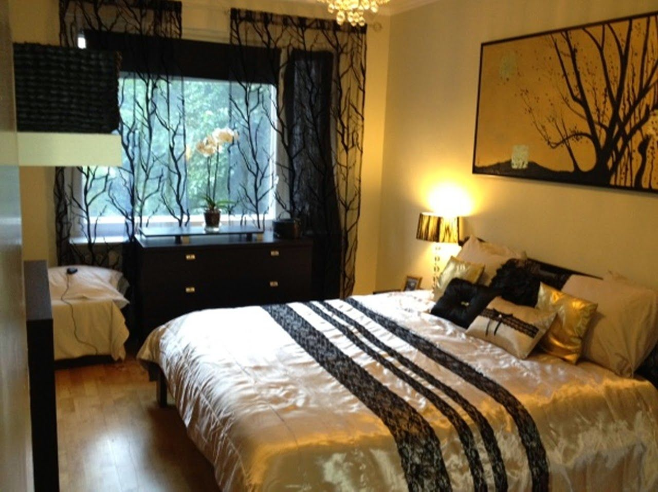 love the black sheer curtains, the bedding and the painting on the