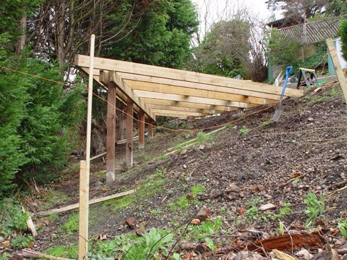Backyard with steep slope image gives a sight as to hop for Building on a slope cost