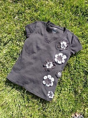 No time to be bored: Flower T-shirt Tutorial - a Refashion. This is a quick and easy t-shirt refab. I think I will try this...thinking a simple butterfly shape would work too.