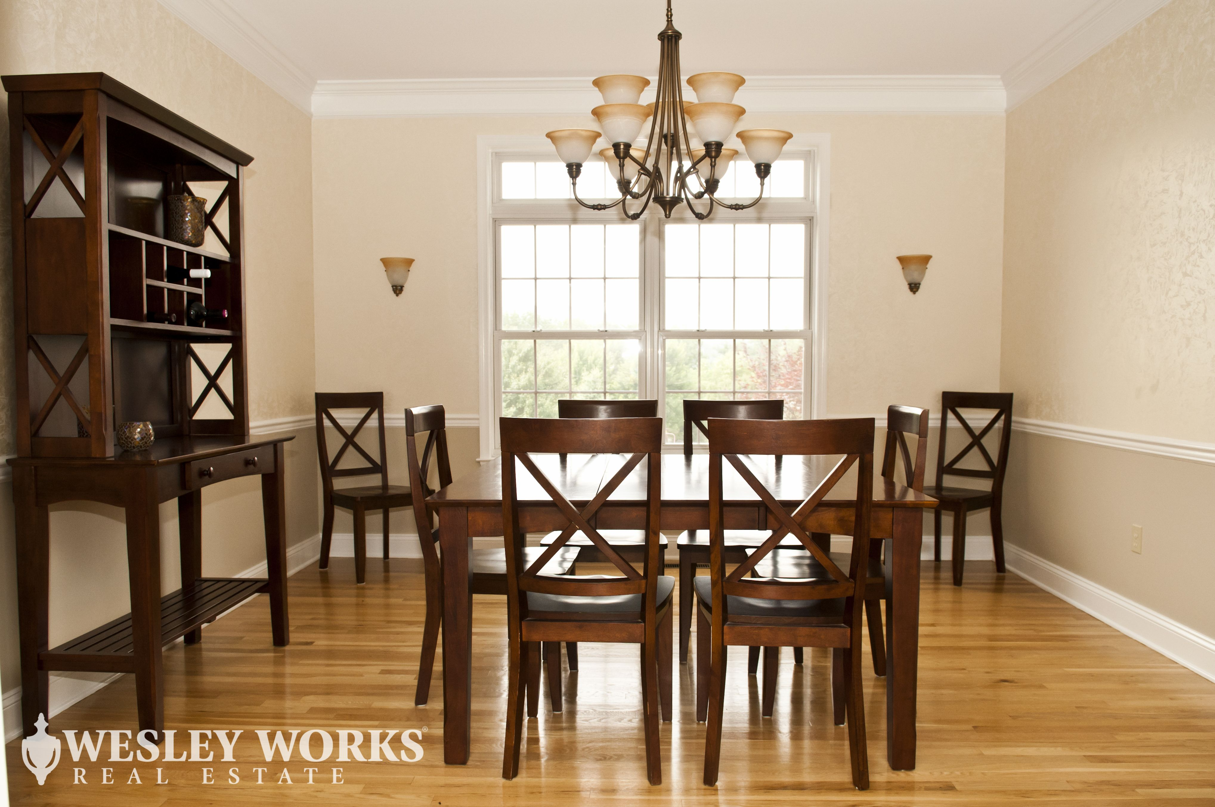 Located On Sutton Rd Traditional Dining Room Featuring Dark Cherry Wood Table Set And China